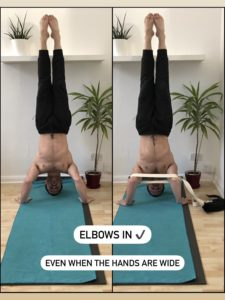 In a headstand you should try to keep your elbows in.